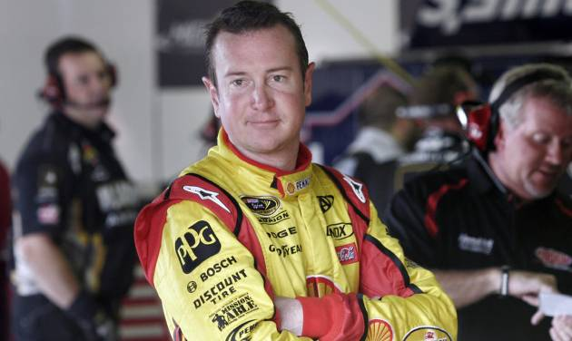 Kurt Busch waits in the garage during practice for the NASCAR Sprint Cup Series Pure Michigan 400 auto race at Michigan International Speedway in Brooklyn, Mich., Saturday, Aug. 20, 2011. (AP Photo/Luke Brodbeck) ORG XMIT: MIPS102