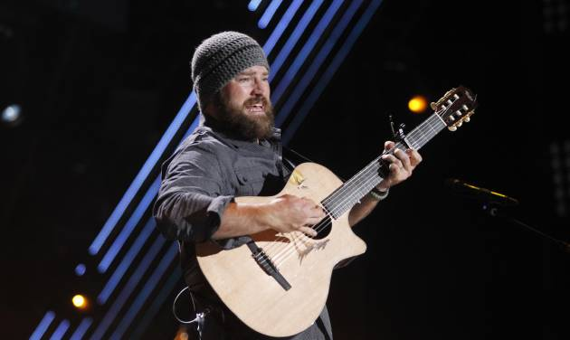 """FILE - In this June 9, 2011 file photo, Zac Brown of the Zac Brown Band performs during the CMA Fan Fest in Nashville, Tenn. The group's latest album, """"Uncaged,"""" is scheduled for release on July 10. (AP Photo/Wade Payne, File)"""