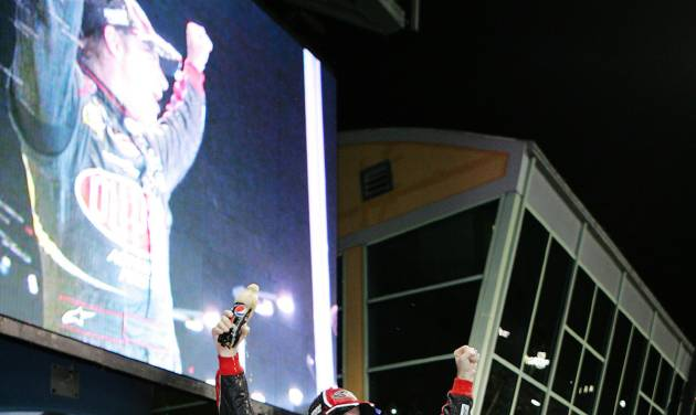 Jeff Gordon celebrates after winning the NASCAR Sprint Cup auto race at Homestead-Miami Speedway, in Homestead, Fla., Sunday, Nov. 18, 2012. (AP Photo/The Miami Herald, Peter Andrew Uloza) MAGS OUT