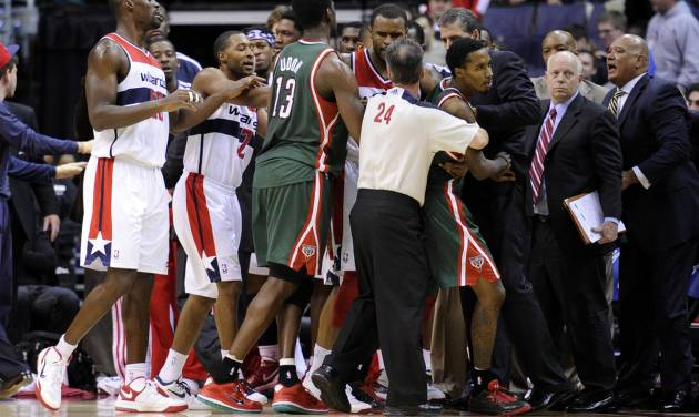 Members of the Washington Wizards and Milwaukee Bucks, including Brandon Jennings, third from right, scuffle during the second half of an NBA basketball game after a hard foul by Wizards guard Bradley Beal on Bucks guard Monta Ellis, Friday, Nov. 9, 2012, in Washington. The Bucks won 101-91. (AP Photo/Nick Wass)