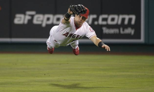Los Angeles Angels right fielder Kole Calhoun catches a ball hit by Los Angeles Dodgers' Matt Kemp during the eighth inning of a baseball game Wednesday, Aug. 6, 2014, in Anaheim, Calif. (AP Photo/Jae C. Hong)