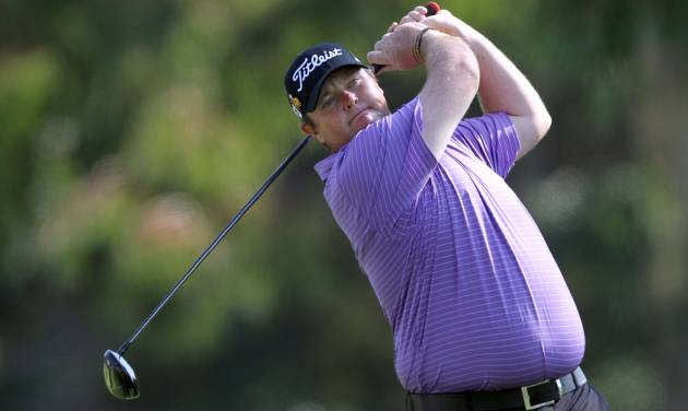 FILE - In this Feb. 19, 2012 file photo, Jarrod Lyle, of Australia, watches his drive on the second tee in the final round of the Northern Trust Open golf tournament at Riviera Country Club in Los Angeles. When cancer survivor Lyle returns to golf after a 20-month layoff at the Australian Masters in Royal Melbourne on Thursday, Nov. 14, 2013, he expects a number of teary eyes on the tee. His among them. (AP Photo/Reed Saxon, File)