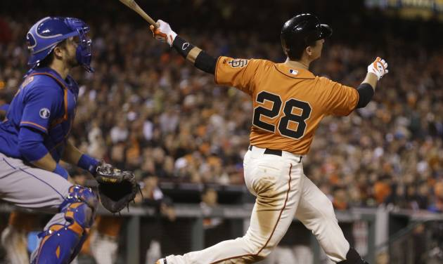 San Francisco Giants' Buster Posey follows through after hitting a two run home run off New York Mets' Carlos Torres in the eighth inning of a baseball game Friday, June 6, 2014, in San Francisco. (AP Photo/Ben Margot)
