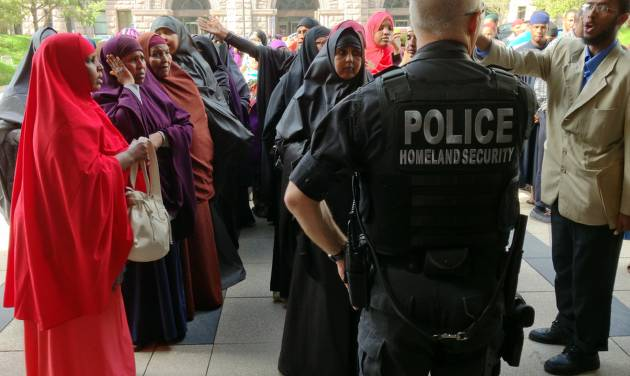Supporters of two Somali women scheduled to be sentenced for helping a terrorist group gather outside the Hennepin County Government Center on Thursday, May 16, 2013, in Minneapolis.   The two women being sentenced went door-to-door in the name of charity to collect money for the terror group al-Shabab in Somalia.  (AP Photo/The Star Tribune, )  MANDATORY CREDIT; ST. PAUL PIONEER PRESS OUT; MAGS OUT; TWIN CITIES TV OUT