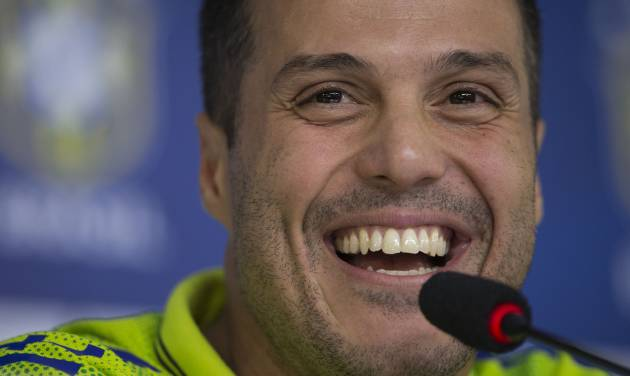 Brazil's goalkeeper Julio Cesar answers questions during a news conference at the Granja Comary training center in Teresopolis, Brazil, Tuesday, May 27, 2014. Brazil is hosting the World Cup soccer tournament which starts in June. (AP Photo/Felipe Dana)