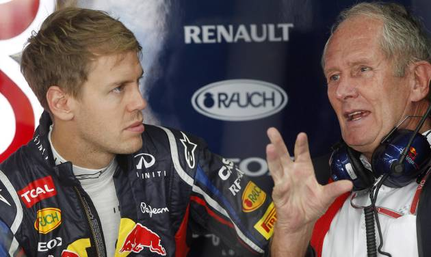 Red Bull driver Sebastian Vettel of Germany chats with Austrian Helmut Marko, right, during the first practice session for the Korean Formula One Grand Prix at the Korean International Circuit in Yeongam, South Korea, Friday, Oct. 12, 2012. (AP Photo/Greg Baker)