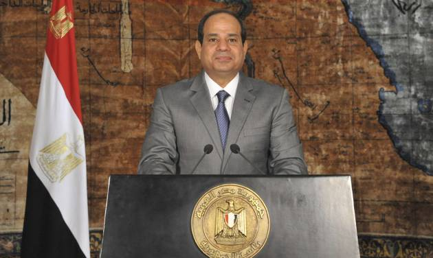 """This image released by Egypt's official Middle East News Agency (MENA), shows Egyptian President Abdel-Fattah el-Sissi during a nationally televised broadcast in Cairo, Egypt, Monday, July 7, 2014. El-Sissi has defended his recent decisions to partially lift subsidies on fuel, calling them a necessary """"bitter pill"""" and he couldn't delay such decisions even if it cost him support because """"the dangers are great"""" for Egypt's economy. He urged Egyptians to bear the austerity measures and appealed to the rich to donate to Egypt's development. Likening the current conditions to times of wars with Israel, el-Sissi said Egypt is at war to rebuild following turmoil. (AP Photo/Ahmed Fouad, MENA)"""