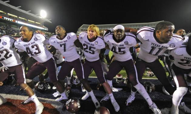 Texas A&M players sing their fight song as they celebrate a 30-27 win over Mississippi in an NCAA college football game in Oxford, Miss., Saturday, Oct. 6, 2012. (AP Photo/The Daily Mississippian, Austin McAfee) MANDATORY CREDIT