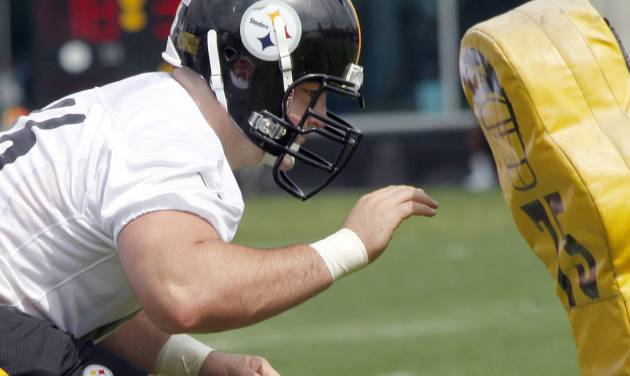 Pittsburgh Steelers number one draft choice, David DeCastro, an offensive guard from Stanford, does a blocking drill during the NFL football team's rookie minicamp at their facility in Pittsburgh on Friday, May 4, 2012. (AP Photo/Keith Srakocic)