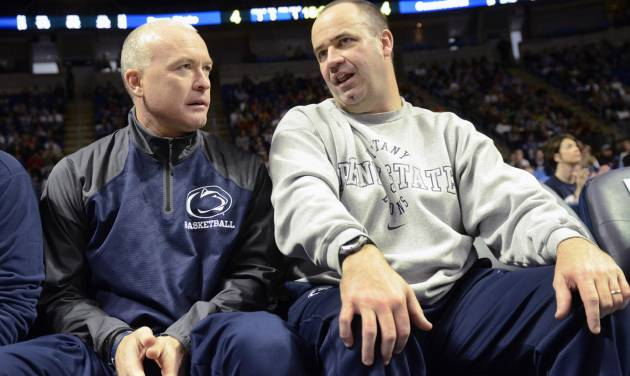 Penn State head men's basketball coach Patrick Chambers, left, and Penn State head football coach Bill O'Brien talk during a timeout of the Penn State against Connecticut women's NCAA college basketball game on Sunday, Nov. 17, 2013, in State College, Pa. Connecticut defeated Penn State  71 - 52. (AP Photo/John Beale)