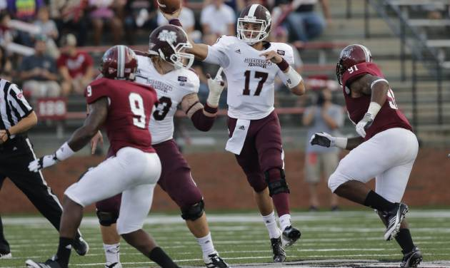 Mississippi State quarterback Tyler Russell (17) passes the ball as Troy defensive tackle Shermane TeArt (91) pursues in the first half of an NCAA college football game in Troy, Ala., Saturday, Sept. 15, 2012. (AP Photo/Dave Martin)