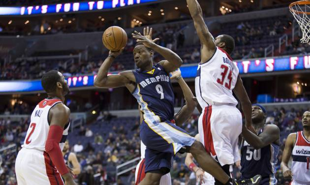 Memphis Grizzlies shooting guard Tony Allen (9) looks to pass the ball as he is defended by Washington Wizards point guard John Wall (2) and Washington Wizards forward Trevor Booker (35) during the first half of an NBA basketball game on Monday, March 3, 2014, in Washington. (AP Photo/ Evan Vucci)