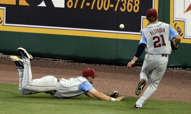 Oklahoma right fielder Taylor Alspaugh (21) heads past center fielder Max White to chase down the ball White dove for and missed during the eighth inning of an NCAA college baseball tournament regional game against LSU, Friday, June 7, 2013, in Baton Rouge, La. LSU won 2-0. (AP Photo/Bill Feig) ORG XMIT: LABF116