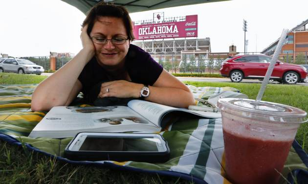 Valerie Cook, of Houston, takes it easy Friday after claiming her tailgating spot across from Gaylord Family — Oklahoma Memorial Stadium. Photo by Steve Sisney, The Oklahoman   Steve Sisney -  STEVE SISNEY