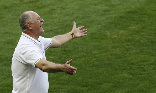 Brazil's coach Luiz Felipe Scolari instructs his players during the World Cup round of 16 soccer match between Brazil and Chile at the Mineirao Stadium in Belo Horizonte, Brazil, Saturday, June 28, 2014. (AP Photo/Hassan Ammar)