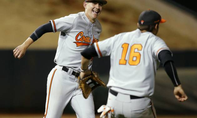 OSU's Vraig McConaughy, left, and Tanner Krietemeier celebrate after winning the Bedlam baseball game between the University of Oklahoma and Oklahoma State University at L. Dale Mitchell Park in Norman, Okla., Tuesday, April 1, 2014. Oklahoma State won 3-1. Photo by Bryan Terry, The Oklahoman