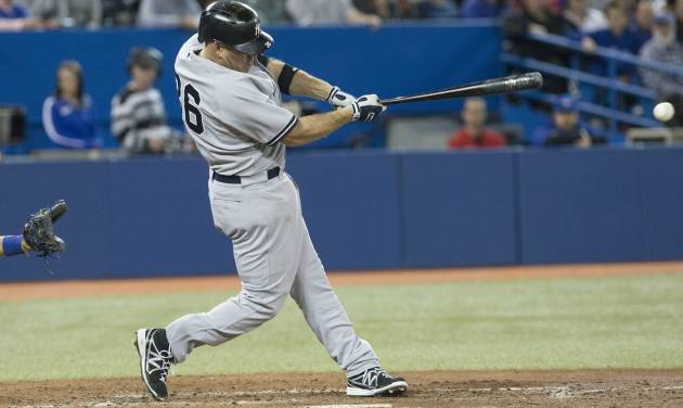 New York Yankee'  Kevin Youkilis hits a two run RBI single off Toronto Blue Jays pitcher Mark Buehrle during the fifth inning of a baseball game in Toronto on Saturday, April 20, 2013. Two runs scored on the hit. (AP Photo/The Canadian Press, Chris Young)