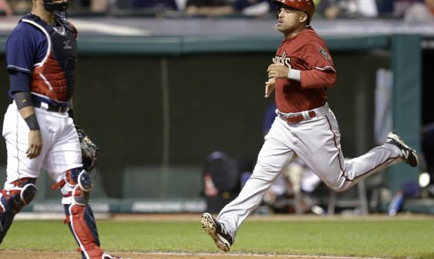 Arizona Diamondbacks' Xavier Paul, right, scores as Cleveland Indians catcher Yan Gomes waits in the 12th inning of the second baseball game of a doubleheader, Wednesday, Aug. 13, 2014, in Cleveland. The Diamondbacks defeated the Indians 1-0. (AP Photo/Tony Dejak)