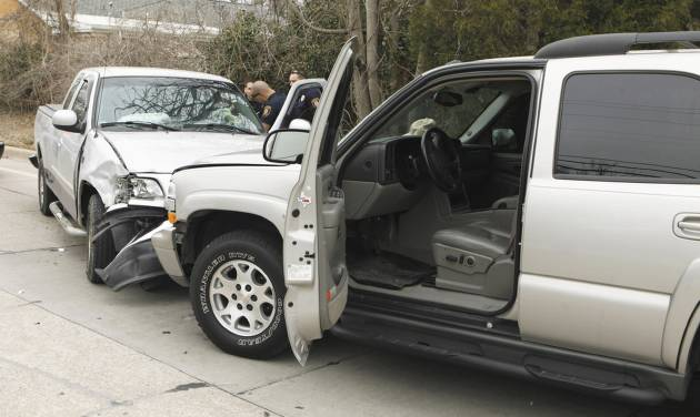 The driver of the pickup, at left, fled from a traffic stop Tuesday before crashing her vehicle and being arrested in Norman.Photo by Steve Sisney, The Oklahoman