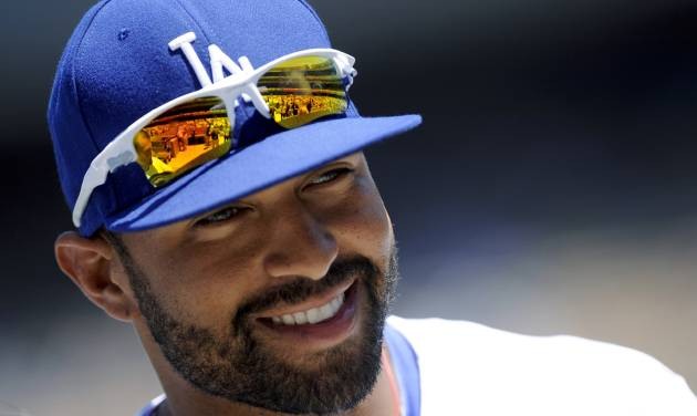 Los Angeles Dodgers center fielder Matt Kemp smiles before the start of a baseball game against the San Diego Padres, Sunday, July 15, 2012, in Los Angeles. (AP Photo/Gus Ruelas) ORG XMIT: LAD106