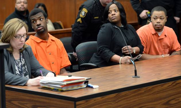 From left, Ed Thomas and Kristopher Pratt, both of Detroit, suspected in the death of Eastern Michigan student and football player Demarius Reed, look on during a preliminary exam in the 14A-1 district court in Pittsfield Township, Mich., on Wednesday, January 29, 2014. The exam was postponed until February, 3 at 2:30 p.m. (AP Photo/The Ann Arbor News, Melanie Maxwell)