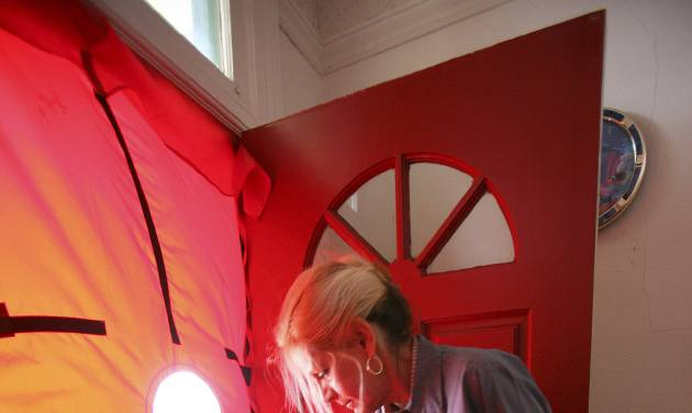 FILE - In this Feb. 26, 2010 file photo, Roseann Mitchell, of the Community Action Agency, checks airflow readings as part of a blower door test assessment in San Francisco. Electricity prices are expected to rise faster this year than they have since 2009, to a record average of 12.5 cents per kilowatt-hour, according to the Energy Department. And prices are highest in the summer, just when you need more power to run the air conditioner. (AP Photo/Ben Margot, File)