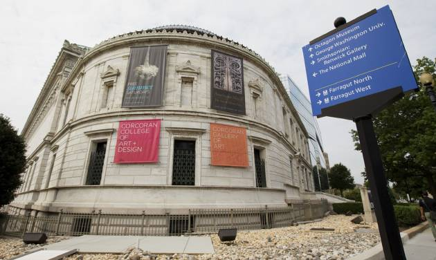 The Corcoran Gallery of Art in Washington, Monday, Aug. 18, 2014. A District of Columbia judge has decided to approve a proposed merger of one of the nation's oldest museums with two larger institutions in Washington. The ruling Monday from Judge Robert Okun allows the Corcoran to merge the museum and its college into George Washington University and the National Gallery of Art, effectively dissolving the independent art gallery and handing over its $2 billion in assets. (AP Photo/Manuel Balce Ceneta)