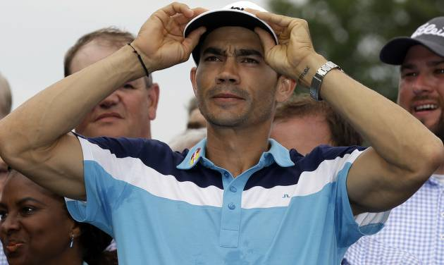 Camilo Villegas, of Colombia, reacts on the 18th green after winning the Wyndham Championship golf tournament in Greensboro, N.C., Sunday, Aug. 17, 2014. (AP Photo/Gerry Broome)