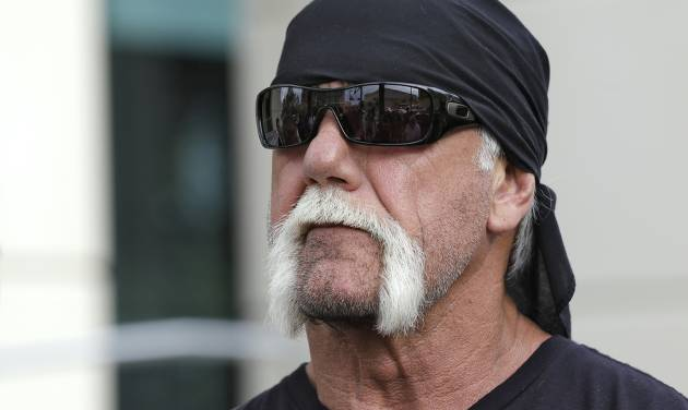 "Reality TV star and former pro wrestler Hulk Hogan, whose real name is Terry Bollea, looks on as his attorney speaks during a news conference Monday, Oct. 15, 2012 at the United States Courthouse in Tampa, Fla. Hogan says he was secretly taped six years ago having sex with the ex-wife of DJ Bubba ""The Love Sponge"" Clem. Portions of the video of Hogan and Heather Clem were posted on the online gossip site Gawker. (AP Photo/Chris O'Meara)"