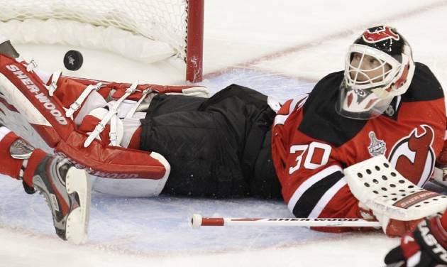 New Jersey Devils goalie Martin Brodeur looks over his shoulder after Los Angeles Kings' Anze Kopitar scored the winning goal during overtime in Game 1 of the NHL hockey Stanley Cup finals Wednesday, May 30, 2012, in Newark, N.J. The Kings won 2-1. (AP Photo/Kathy Willens)