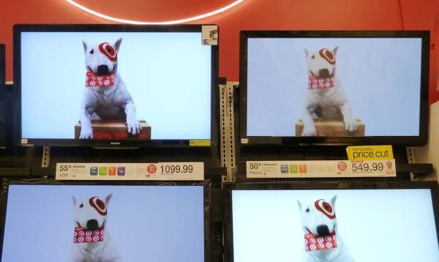 In this Feb. 20, 2012 photo, flat screen televisions are displayed at Target in Methuen, Mass. Target Corp. is reporting a 5.2 percent drop in earnings for the fourth quarter, as the discounter pushed big discounts to get tight-fisted shoppers to buy during the holiday season. (AP Photo/Elise Amendola)