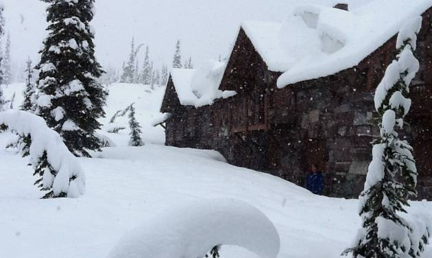 A photo provided by Glacier National Park shows the Sperry Chalet in Glacier National Park, Mont., Wednesday June 18, 2014.   National Weather Service  employees at Sperry Chalet report 14-16 inches of snow since Tuesday, June 17, 2014 morning. Tourists hunkered down in lodges, snow plowing crews stood down, and park officials were preparing for possible employee evacuations from the St. Mary area. (AP Photo/ Denise Germann)