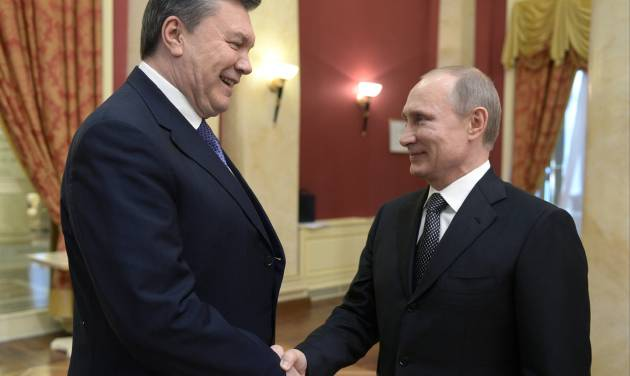 FILE - A Friday, Feb. 7, 2014 photo from files showing Russian President Vladimir Putin, right, shaking hands with Ukrainian President Viktor Yanukovych at the Olympic reception hosted by the Russian President in Sochi, Russia. Russia questioned the legitimacy of the new Ukrainian authorities on Monday, Feb. 24, 2014, with its prime minister saying it sees the turmoil in Ukraine as a threat to both Russian citizens and Russian interests in Ukraine. (AP Photo/RIA-Novosti, Alexei Nikolsky, Presidential Press Service, Pool, File)