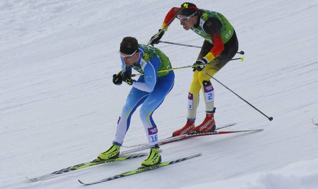 Germany's Tim Tscharnke, right, makes contact with the skis of Finland's Sami Jauhojaervi, left, before falling in the men's classical-style final of the cross-country team sprint competitions at the 2014 Winter Olympics, Wednesday, Feb. 19, 2014, in Krasnaya Polyana, Russia. (AP Photo/Dmitry Lovetsky)