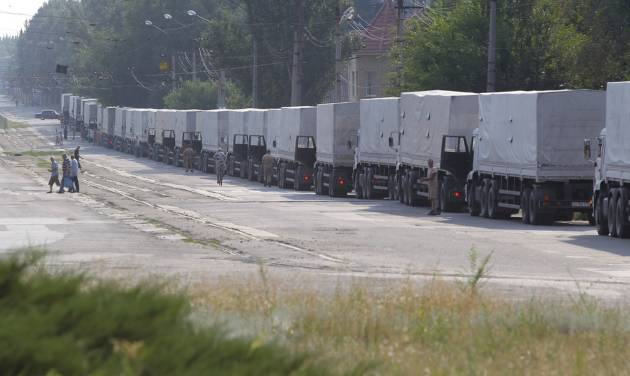 Drivers of the first trucks of the Russian aid convoy are parked in the city of Luhansk, eastern Ukraine, Friday, Aug. 22, 2014. The first trucks in a Russian aid convoy crossed into eastern Ukraine on Friday, after more than a week's delay. (AP Photo/Sergei Grits)