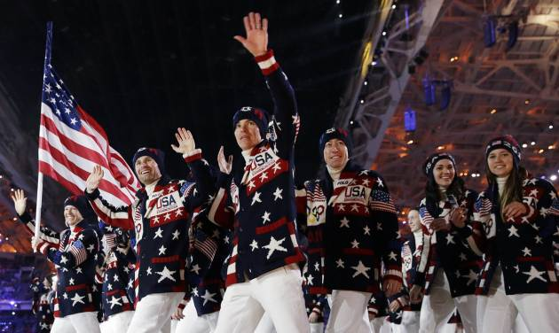 FILE - This Feb. 7, 2014 file photo shows the United States team arrives during the opening ceremony of the 2014 Winter Olympics in Sochi, Russia. Ralph Lauren's love for the American flag and American style earned him high honors Tuesday, June 17, from the Smithsonian Institution, celebrating his five decades in fashion. Lauren designed the uniforms for the US Winter Olympic team. (AP Photo/Patrick Semansky, File)