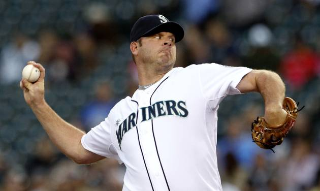 Seattle Mariners starting pitcher Kevin Millwood throws to a Boston Red Sox batter in the second inning of a baseball game Wednesday, Sept. 5, 2012, in Seattle. (AP Photo/Elaine Thompson)