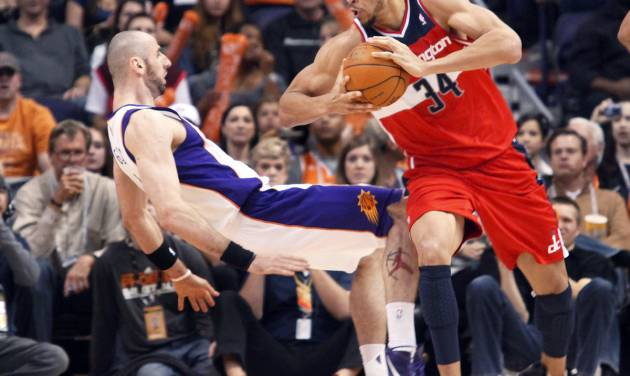 "FILE - In this Feb. 20, 2012, file photo, Phoenix Suns center Marcin Gortat, left, of Poland, falls backward to the floor as Washington Wizards center JaVale McGee, right, is called for a charge in the third quarter of an NBA basketball game in Phoenix. The NBA will penalize flopping this season, fining players for repeated violations of an act a league vice president says has ""no place in our game."" The league said Wednesday, Oct. 3, 2012, that flopping will be defined as ""any physical act that appears to have been intended to cause the referees to call a foul on another player."" (AP Photo/Paul Connors, File)"