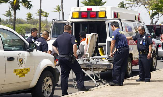 "A 15-year-old boy, seen sitting on a stretcher center, who stowed away in the wheel well of a flight from San Jose, Calif., to Maui is loaded into an ambulance at Kahului Airport in Kahului, Maui, Hawaii Sunday afternoon, April 20, 2014. The boy survived the trip halfway across the Pacific Ocean unharmed despite frigid temperatures at 38,000 feet and a lack of oxygen, FBI and airline officials said. FBI spokesman Tom Simon in Honolulu told The Associated Press on Sunday night that the boy was questioned by the FBI after being discovered on the tarmac at the Maui airport with no identification. ""Kid's lucky to be alive,"" Simon said. (AP Photo/The Maui News, Chris Sugidono)"