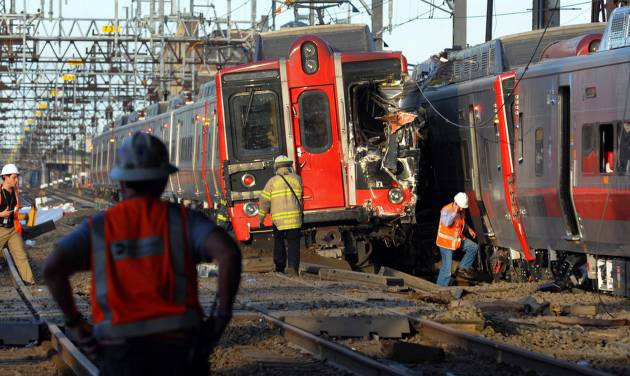 Emergency personnel work at the scene where two Metro North commuter trains collided, Friday, May 17, 2013 near Fairfield, Conn. Bill Kaempffer, a spokesman for Bridgeport public safety, told The Associated Press approximately 49 people were injured, including four with serious injuries. About 250 people were on board the two trains, he said. (AP Photo/The Connecticut Post, Christian Abraham) MANDATORY CREDIT: CONNECTICUT POST, CHRISTIAN ABRAHAM