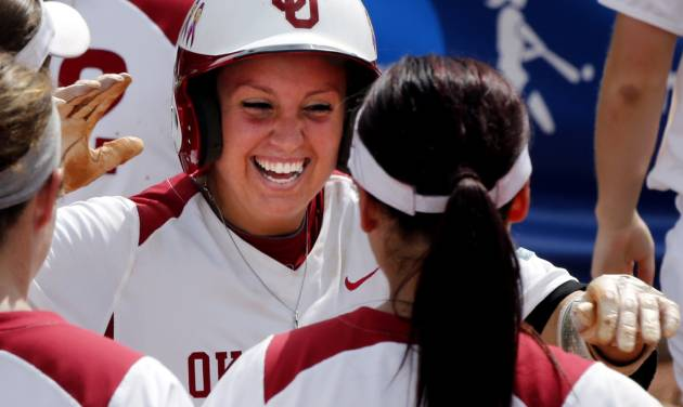 Oklahoma's Javen Henson, facing, celebrates her home run with another home run hitter, Lauren Chamberlain as the University of Oklahoma Sooner (OU) softball team plays Tennessee in game three of the NCAA super regional at Marita Hynes Field on May 25, 2014 in Norman, Okla. Photo by Steve Sisney, The Oklahoman