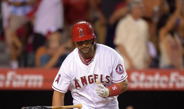 Los Angeles Angels' Albert Pujols tosses his bat as he hits a two-run home run during the seventh inning of a baseball game against the Houston Astros, Saturday, July 5, 2014, in, Anaheim, Calif.  (AP Photo/Mark J. Terrill)