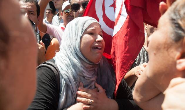 A Tunisian supporter of the Popular Front party reacts at Mahmoud Materi hospital, after Mohammed Brahmi died from his wounds after he was shot to death in his car outside his home, north of Tunis, Tunisia, Thursday, July 25, 2013. Brahmi, 58, of an Arab nationalist political party was in his car outside home when gunmen fired several shots at him, said Interior Ministry spokesman Mohammed Ali Aroui. It is the second killing of an opposition member this year, following that of Chokri Belaid, a member of the same leftist Popular Front coalition as Brahmi. Belaid was also shot dead in his car outside his home in February. His killing provoked a political crisis that nearly derailed Tunisia's political transition. (AP Photo/Amine Landoulsi)