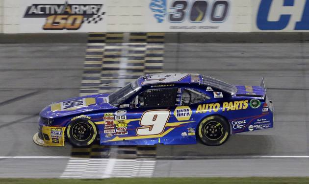 Chase Elliott crosses the finish line as he wins the NASCAR Nationwide Series auto race at Chicagoland Speedway in Joliet, Ill., Saturday, July 19, 2014. (AP Photo/Nam Y. Huh)