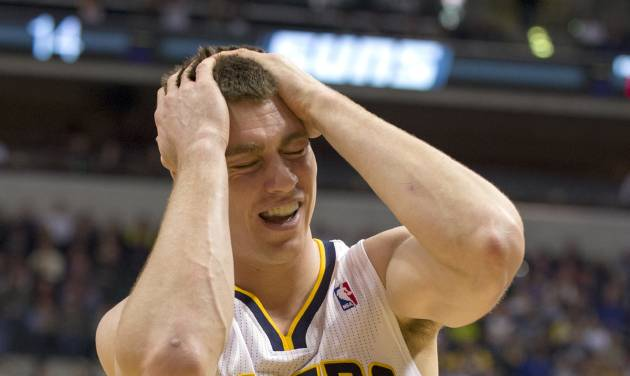 Indiana Pacers' Tyler Hansbrough reacts after being called for his second personal foul during the first half of an NBA basketball game against the Phoenix Suns, in Indianapolis, Friday, Dec. 28, 2012. (AP Photo/Doug McSchooler)