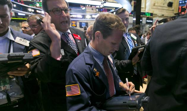 Trader Benedict Willis, left, calls out as he works on the floor of the New York Stock Exchange Friday, Aug. 1, 2014.  U.S. markets steadied on Friday a day after a major sell-off. Investors focused on a relatively strong jobs report, which showed the U.S. economy created 209,000 jobs in July, the sixth straight month of job growth above 200,000. (AP Photo/Richard Drew)