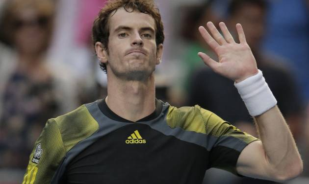 Britain's Andy Murray celebrates after defeating France's Gilles Simon in their fourth round match at the Australian Open tennis championship in Melbourne, Australia, Monday, Jan. 21, 2013. (AP Photo/Rob Griffith)