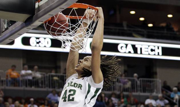 FILE - In this March 24, 2012, file photo, Baylor center Brittney Griner dunks the ball during the second half of an NCAA women's tournament regional semifinal college basketball game against Georgia Tech in Des Moines, Iowa. President Barack Obama is going with Griner and Baylor to win back-to-back titles in the NCAA women's basketball tournament. Obama's pick was announced Friday, March 22, 2013 on ESPN.  (AP Photo/Charlie Neibergall, File)