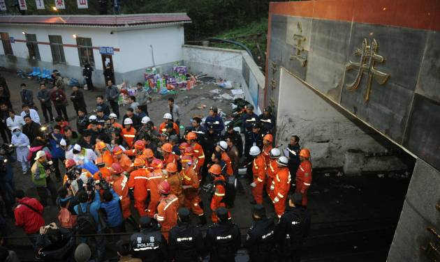 A rescued miner is carried out of the mine shaft of a flooded coal mine in Weng'an County, southwest China's Guizhou Province, Monday, April 8, 2013. Chinese state media Xinhua News Agency say three miners have been rescued after spending two and a half days trapped underground because of flooding in the coal mine that killed three of their colleagues. (AP Photo/Xinhua, Liu Xu)  NO SALES