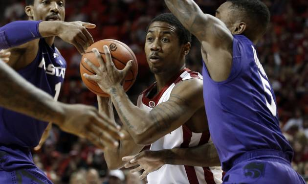 Oklahoma Sooner's Je'lon Hornbeak (5) drives between defenders in the first half as the University of Oklahoma Sooner (OU) men play the Kansas State Wildcats (KS) in NCAA, college basketball at The Lloyd Noble Center on Saturday, Feb. 22, 2014 in Norman, Okla. Photo by Steve Sisney, The Oklahoman
